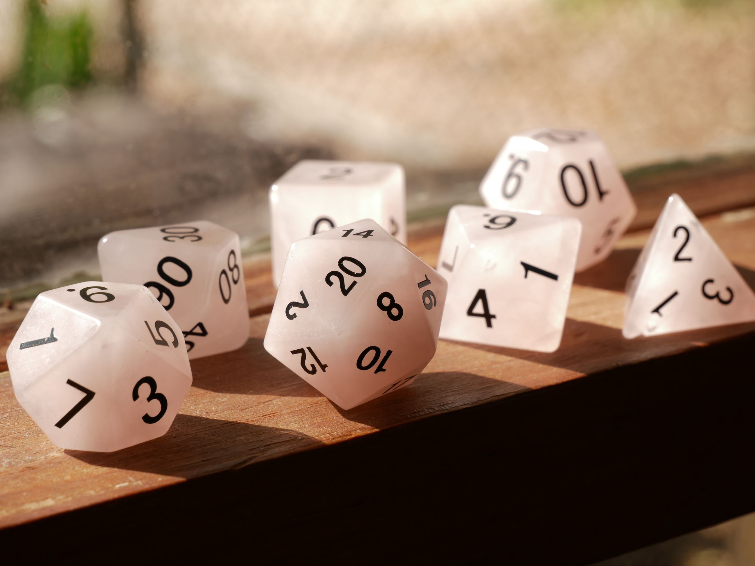 set of polyhedral dice on windowsill